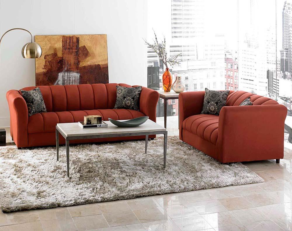 Orange sofa and love seat room arrangement